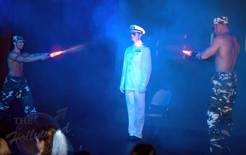 Sarge Logan performs in a Naval Officer strip act